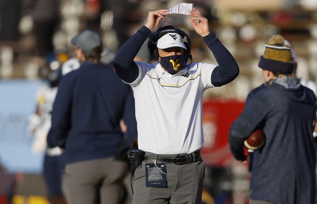 West Virginia head coach Neal Brown reacts after his team was stopped short of a first down during the first half of an NCAA college football game aga...