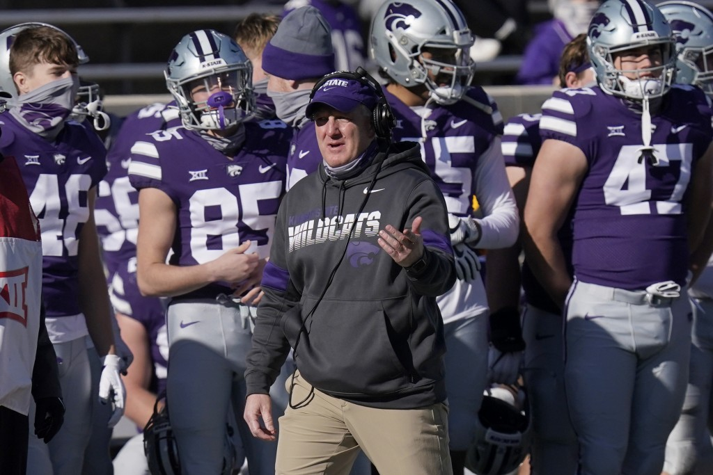 Kansas State head coach Chris Klieman directs his team during the first half of an NCAA college football game against Texas in Manhattan, Kan., Saturd...
