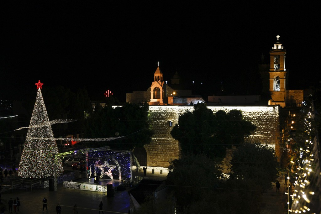 Christmas tree is lit outside the Church of the Nativity, traditionally believed by Christians to be the birthplace of Jesus Christ in the West Bank c...