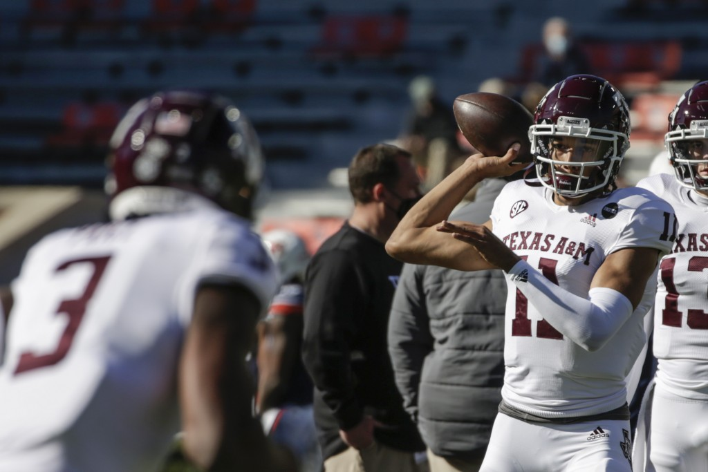 Texas A&M quarterback Kellen Mond (11) warms up before the start of an NCAA college football game against Auburn on Saturday, Dec. 5, 2020, in Auburn,...