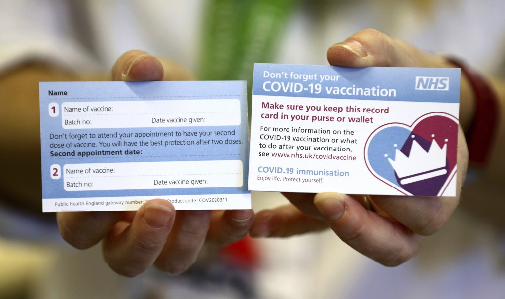Both sides of a record card are displayed, that will be given to all recipients of the Pfizer coronavirus vaccine, at Croydon University Hospital Satu...