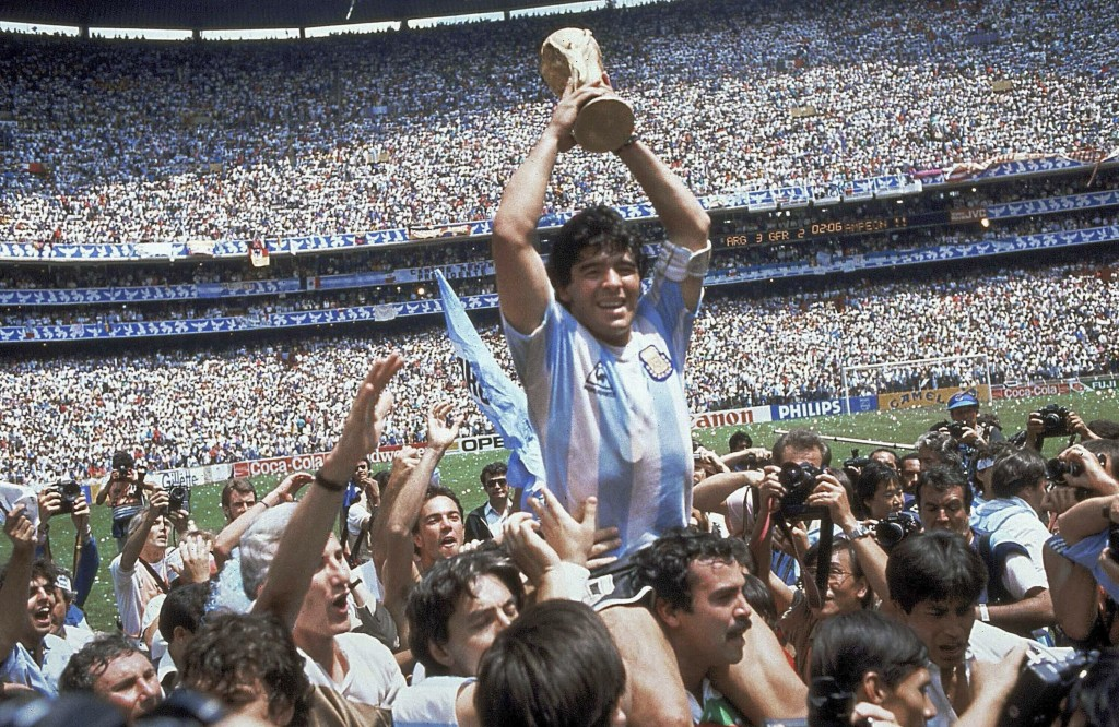 FILE - In this June 29, 1986, file photo, Diego Maradona holds up his team's trophy after Argentina's 3-2 victory over West Germany at the World Cup f...