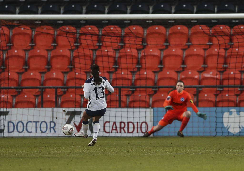 Tottenham Hotspur Women's Alex Morgan scores her side's third goal of the game against Brighton and Hove Albion, during their FA Women's Super League ...