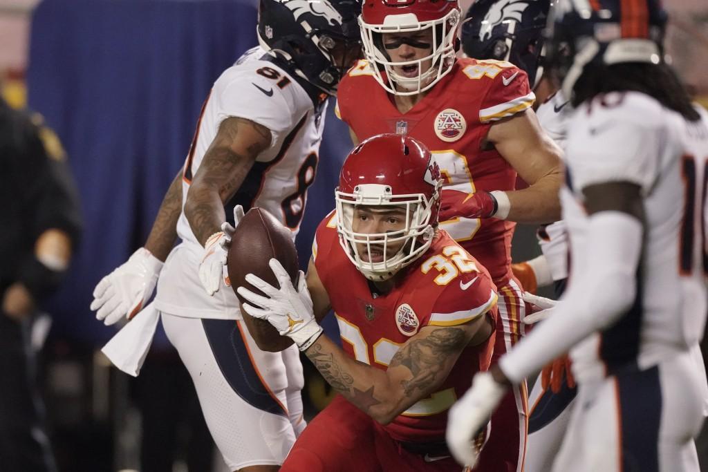 Kansas City Chiefs strong safety Tyrann Mathieu (32) intercepts a Denver Broncos quarterback Drew Lock pass in the first half of an NFL football game ...