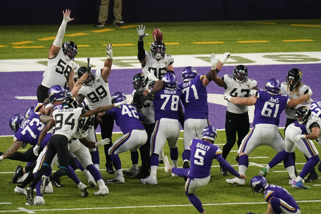 Minnesota Vikings place kicker Dan Bailey (5) kicks a 23-yard field goal during overtime in an NFL football game against the Jacksonville Jaguars, Sun...