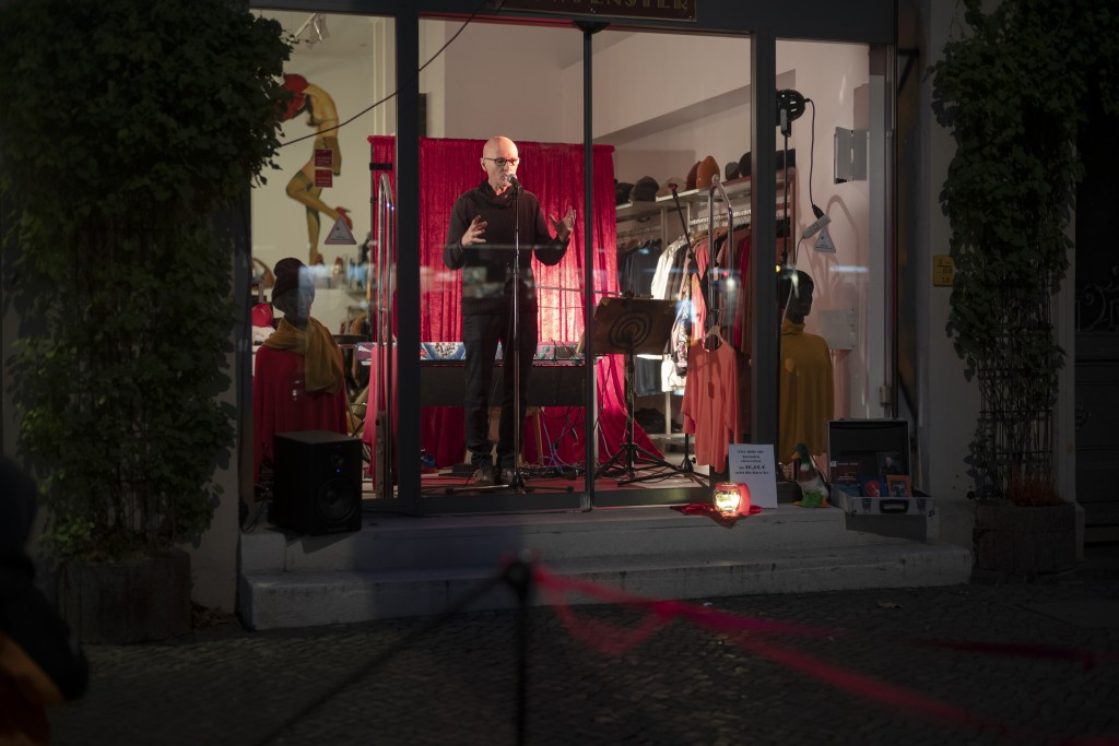 Gerd Norman from a group of independent artists known as Entenfuss Kultur, Duck's Foot Culture, performes at a so-called 'Show Windows' at the distric...