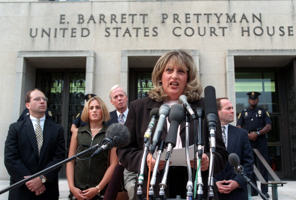 FILE - In this July 29, 1998, file photo Linda Tripp meets with reporters outside federal court in Washington after her final appearance before a gran...