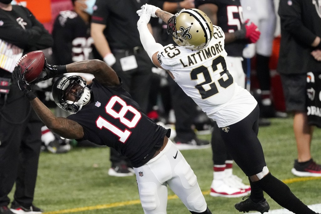 Atlanta Falcons wide receiver Calvin Ridley (18) makes a catch against New Orleans Saints cornerback Marshon Lattimore (23) during the first half of a...