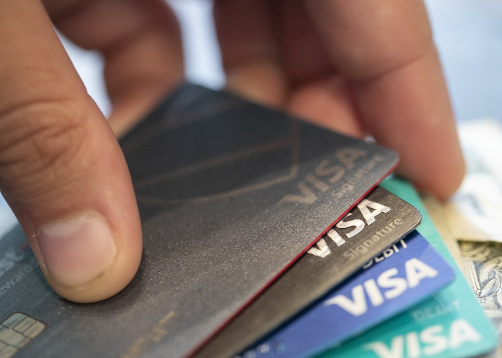 FILE - This Aug. 11, 2019 file photo shows Visa credit cards in New Orleans. The coronavirus pandemic hasn't stopped Americans from keeping up with th...