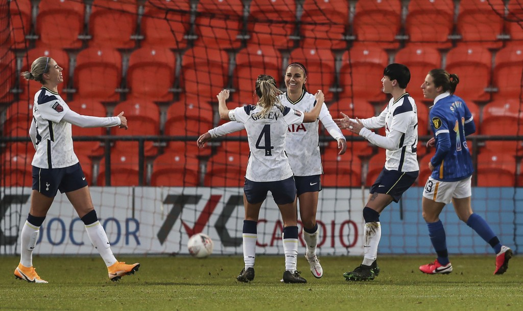 Tottenham Hotspur Women's Alex Morgan, 3rd right, celebrates scoring her side's third goal of the game against Brighton and Hove Albion during their F...