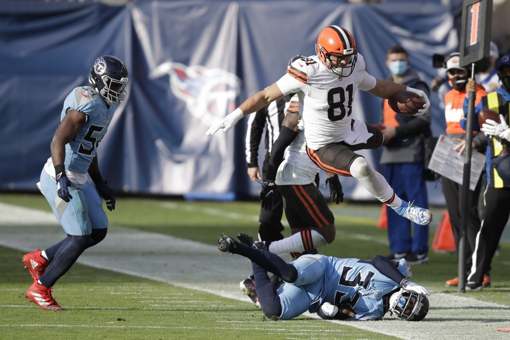 Cleveland Browns tight end Austin Hooper (81) leaps over Tennessee Titans cornerback Desmond King (33) in the second half of an NFL football game Sund...