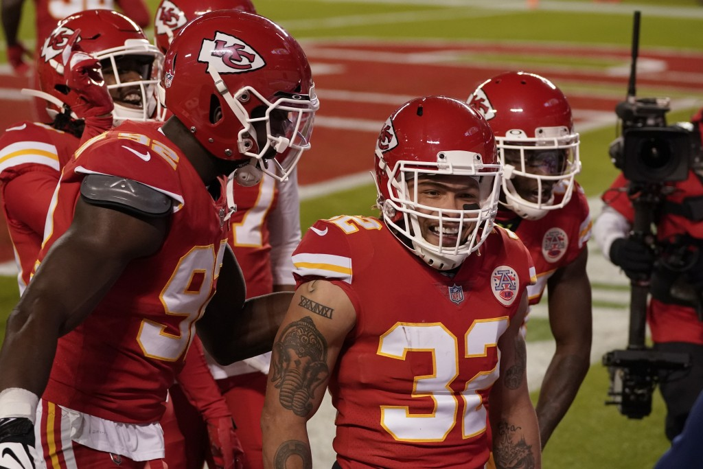 Kansas City Chiefs strong safety Tyrann Mathieu (32) reacts after his interception against the Denver Broncos in the first half of an NFL football gam...