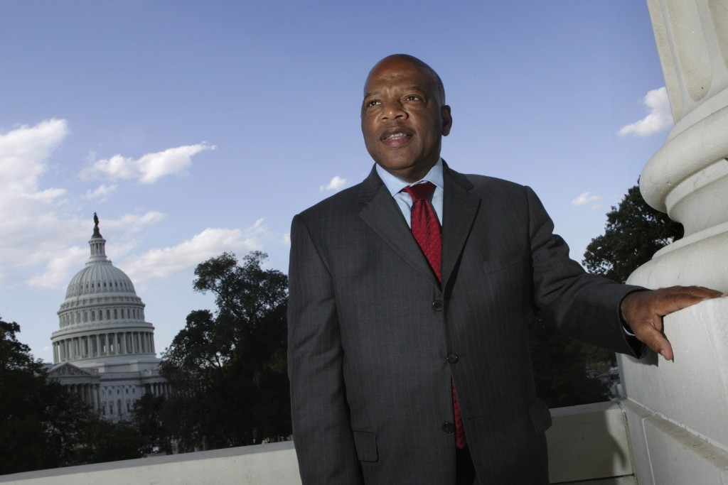 FILE - In this Oct. 10, 2007, file photo, with the Capitol Dome in the background, U.S. Rep. John Lewis, D-Ga., poses on Capitol Hill in Washington. L...