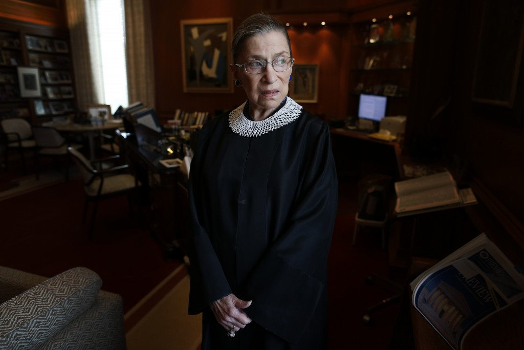 FILE - In this July 24, 2013, file photo, Associate Justice Ruth Bader Ginsburg poses for a photo in her chambers at the Supreme Court in Washington, ...