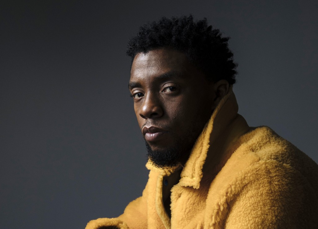 """FILE - In this Feb. 14, 2018 photo, actor Chadwick Boseman poses for a portrait in New York to promote his film, """"Black Panther."""" Boseman, who played ..."""