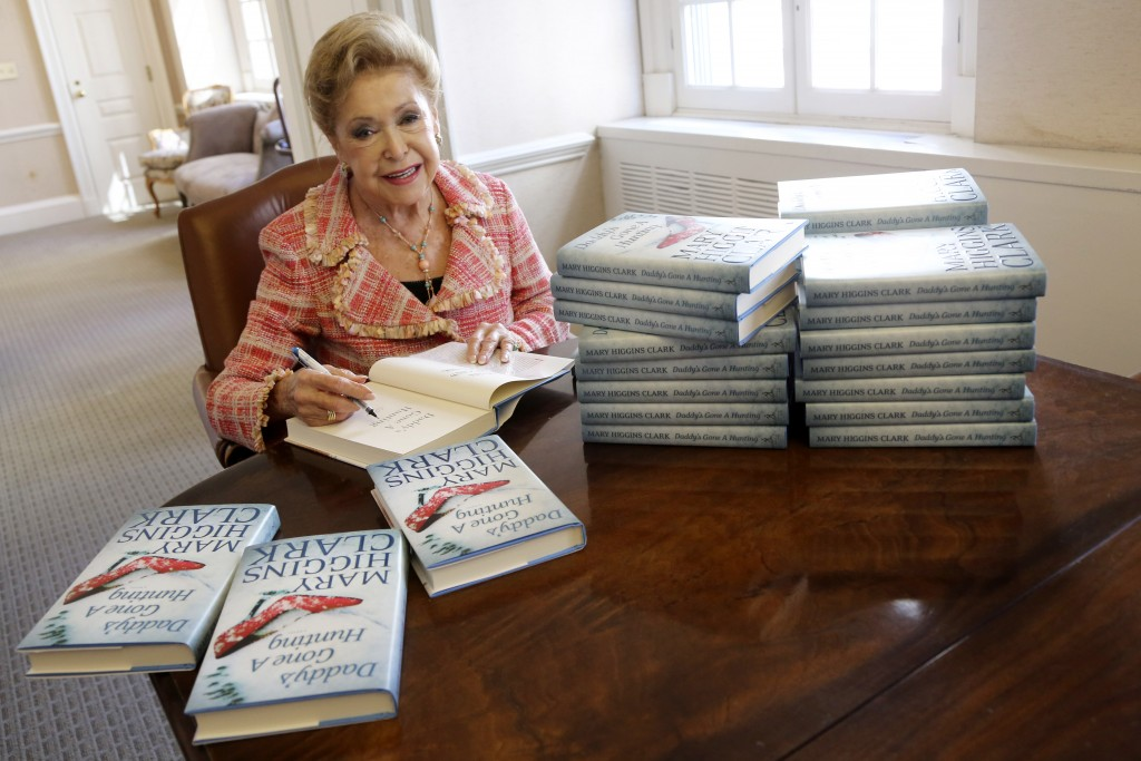 """FILE - In this April 3 2013, file photo, author Mary Higgins Clark sign copies of her latest book """"Daddy's Gone A Hunting"""" at the Simon & Schuster off..."""