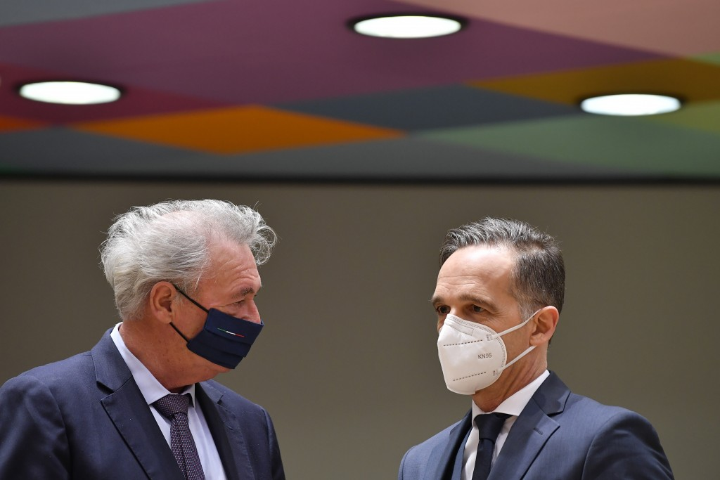 Luxembourg's Foreign Minister Jean Asselborn, left, speaks with German Foreign Minister Heiko Maas during a meeting of EU Foreign Ministers at the Eur...