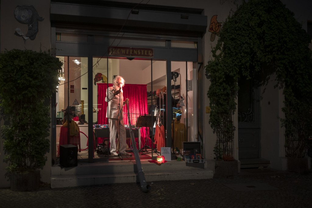 Otto Kuhnle from a group of independent artists known as Entenfuss Kultur, Duck's Foot Culture, performes at a so-called 'Show Windows' at the distric...