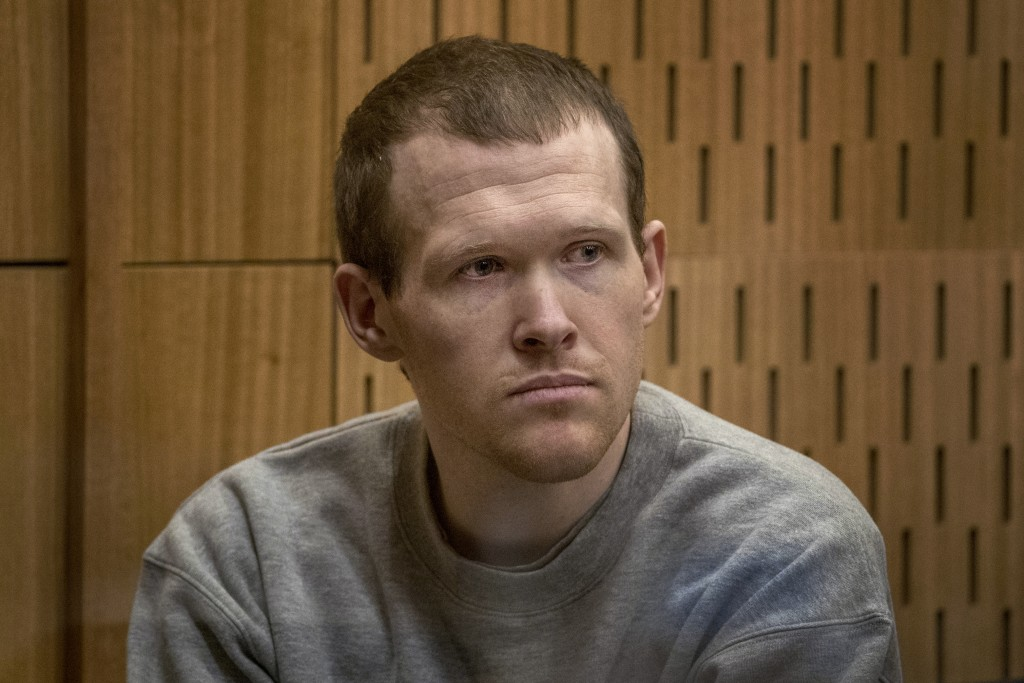 FILE - In this Aug. 24, 2020, file photo, 29-year-old Australian Brenton Harrison Tarrant sits in the dock at the Christchurch High Court for sentenci...