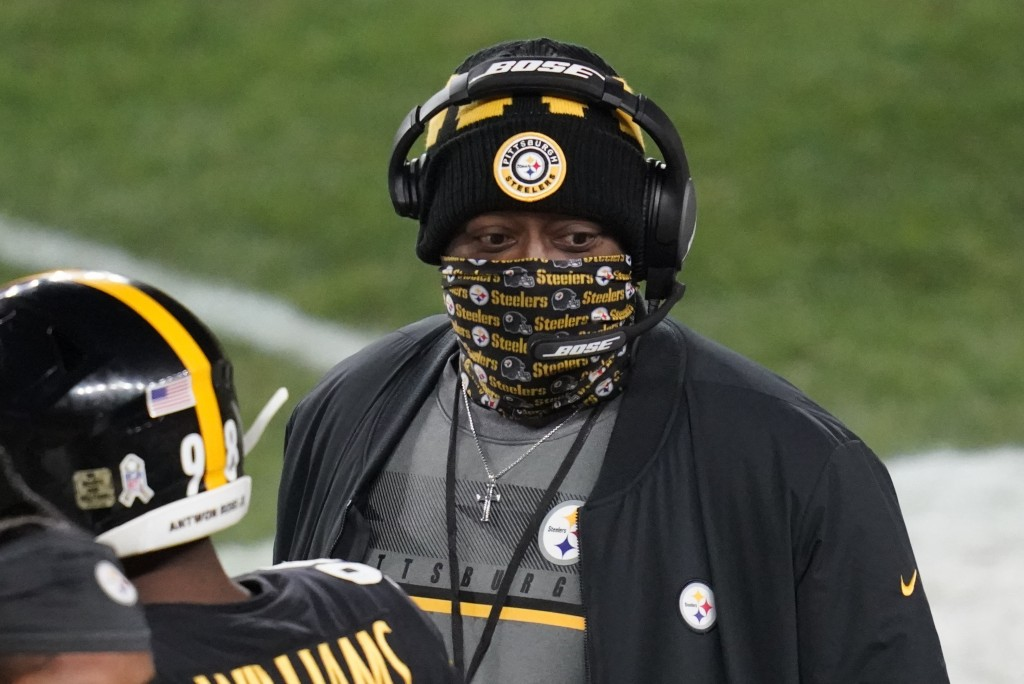 Pittsburgh Steelers head coach Mike Tomlin stands on the sideline during the first half of an NFL football game against the Washington Football Team, ...