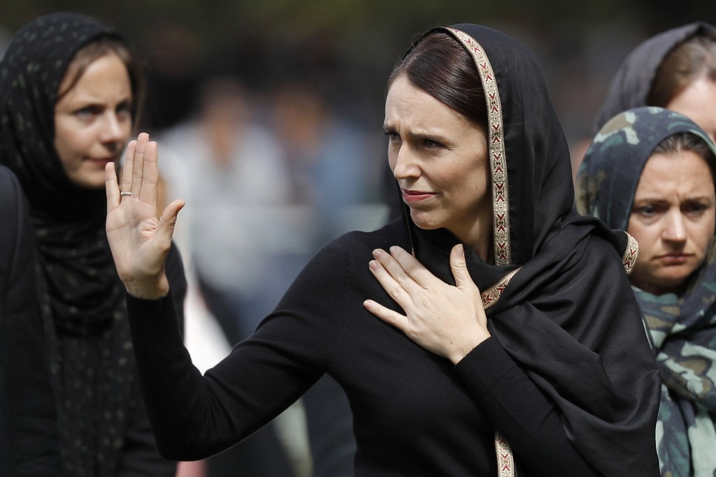 FILE - In this March 22, 2019, file photo, New Zealand Prime Minister Jacinda Ardern, center, waves as she leaves Friday prayers at Hagley Park in Chr...