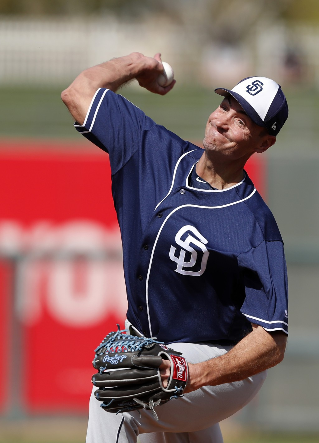 FILE - In this March 1, 2018, file photo, San Diego Padres pitcher Chris Young throws during the third inning of a spring training baseball game again...