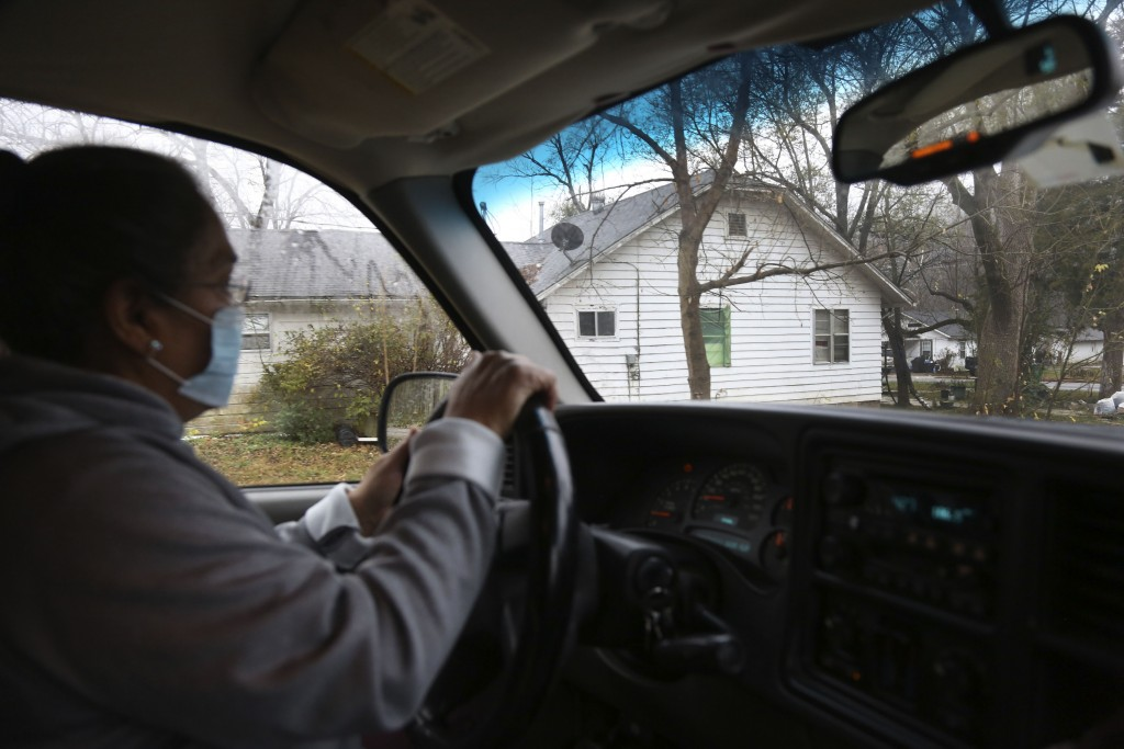 Tyson Foods employee, Silvia De Leon, drives home from a local food pantry at the Community Baptist Church of Noel, in Noel, Mo., on Saturday, Nov. 21...