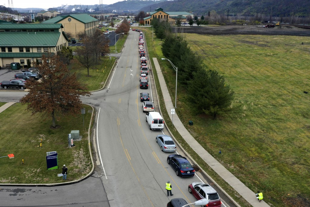 Cars wait in line during a Greater Pittsburgh Community Food bank drive-up food distribution in Duquesne, Pa., Monday, Nov. 23, 2020. While food banks...