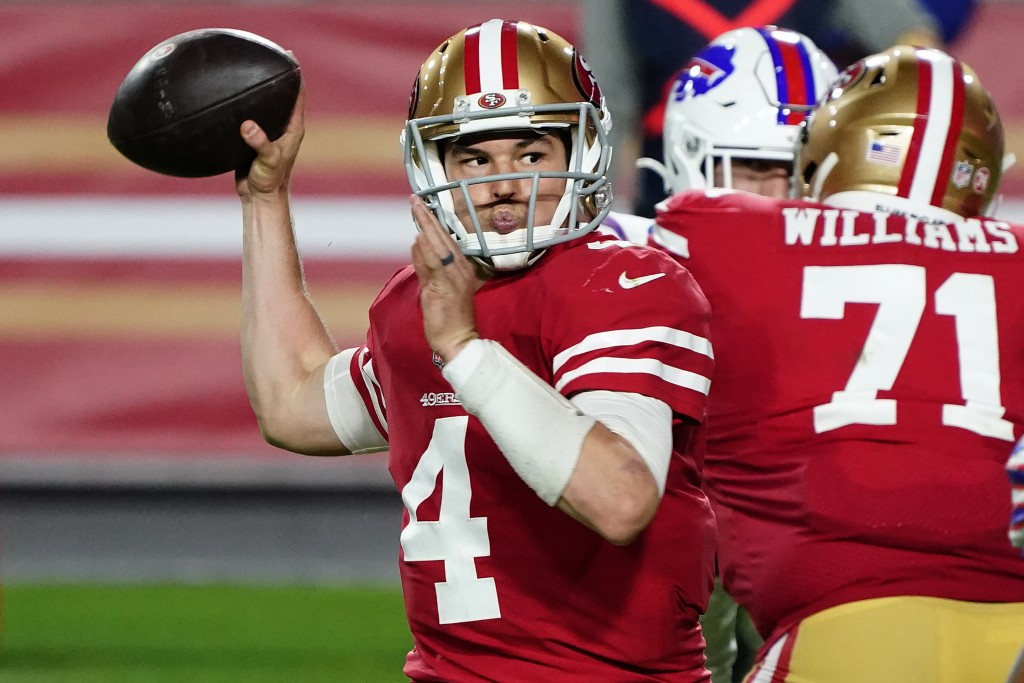 San Francisco 49ers quarterback Nick Mullens (4) throws against the Buffalo Bills during the second half of an NFL football game, Monday, Dec. 7, 2020...