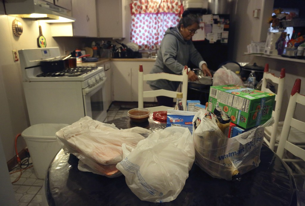 Bags of food from a local church pantry sit on the kitchen table in the home of Silvia De Leon in Noel, Mo., Saturday, Nov. 21, 2020. After losing her...