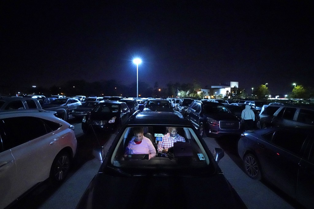 Norman Butler, a first time food bank user, and his girlfriend Cheryl Butler wait overnight in their car, along with others lined up to receive food a...