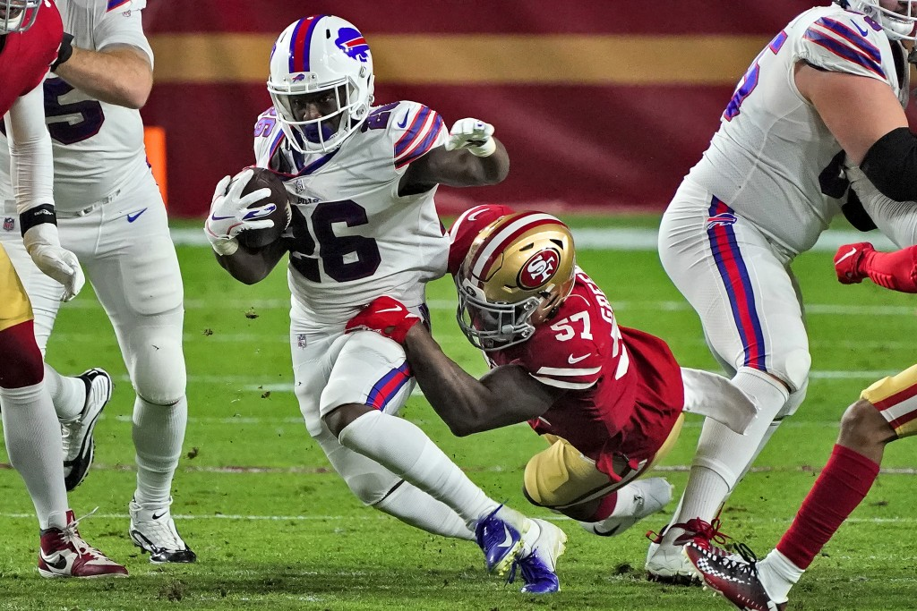 Buffalo Bills running back Devin Singletary (26) is tackled by San Francisco 49ers outside linebacker Dre Greenlaw (57) during the first half of an NF...