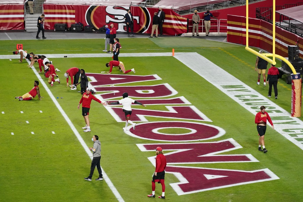 San Francisco 49ers players stretch prior to an NFL football game against the Buffalo Bills, Monday, Dec. 7, 2020, in Glendale, Ariz. (AP Photo/Ross D...