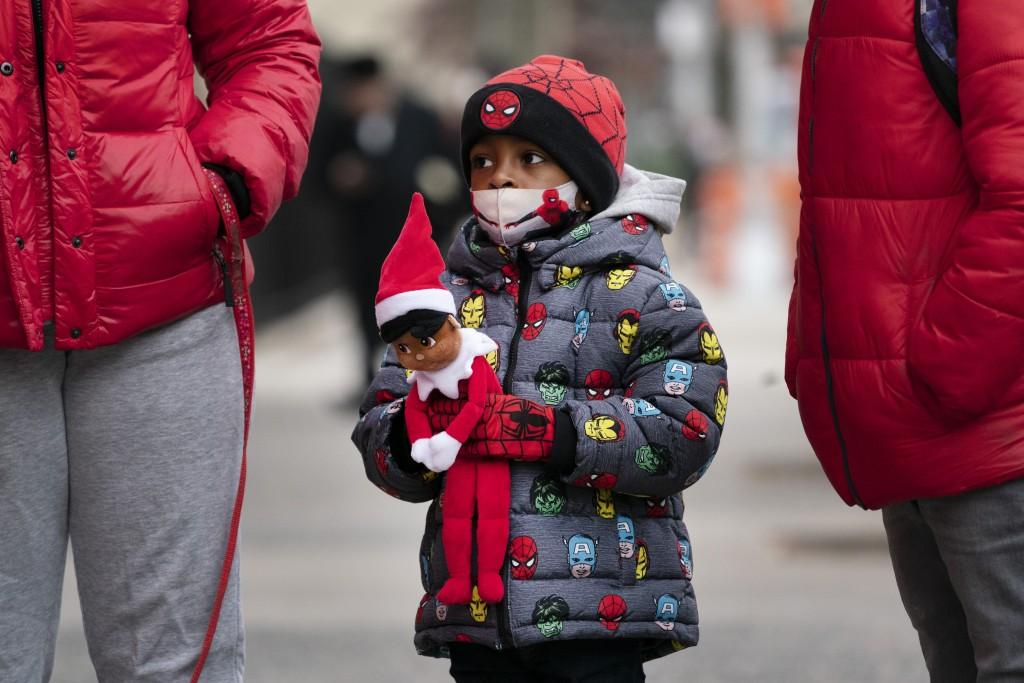 Jayceon Melendez arrives at P.S. 134 Henrietta Szold Elementary School, Monday, Dec. 7, 2020, in New York. Public schools reopened for in-school learn...