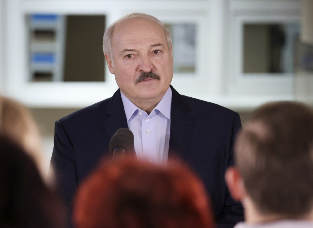 Belarusian President Alexander Lukashenko attends meeting with medical staff as he visits a hospital which provides medical care to patients with COVI...