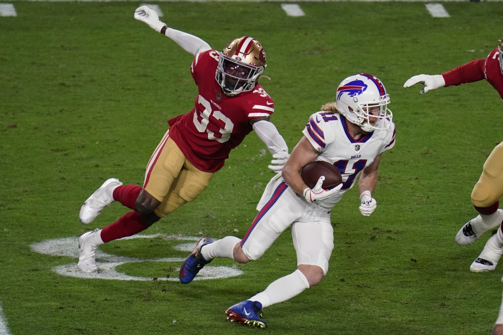 Buffalo Bills wide receiver Cole Beasley (11) tries to escape the reach of San Francisco 49ers defensive back Tarvarius Moore (33) during the first ha...