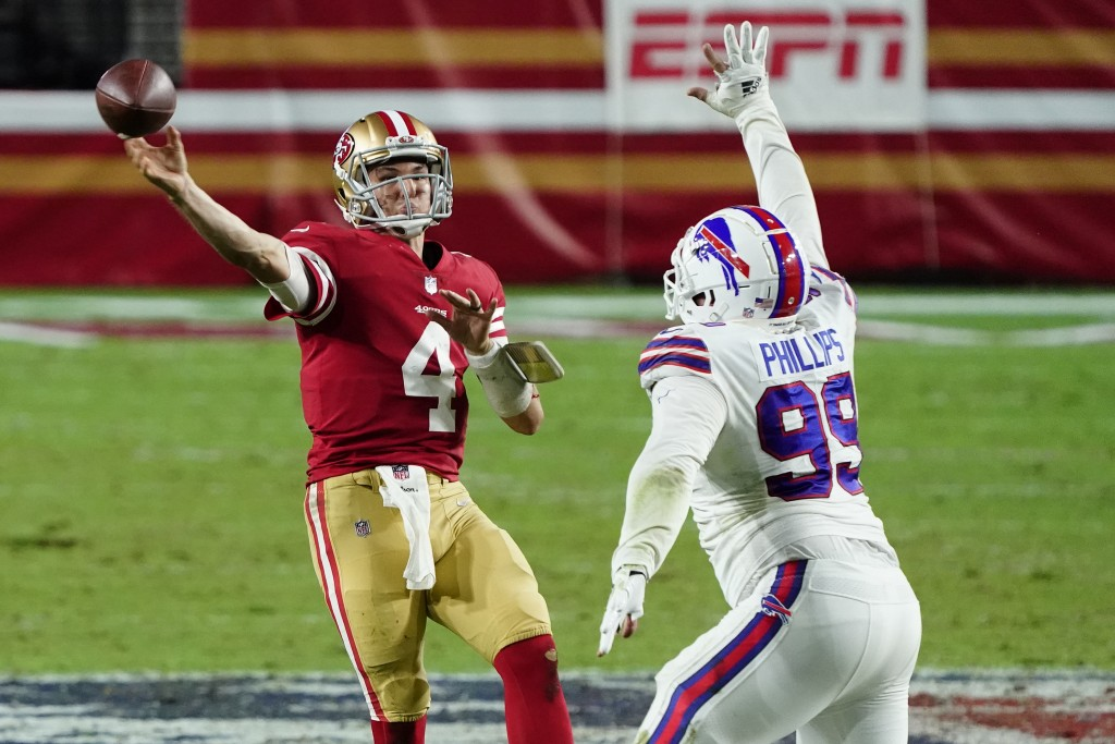 San Francisco 49ers quarterback Nick Mullens (4) throws over Buffalo Bills defensive tackle Harrison Phillips (99) during the second half of an NFL fo...