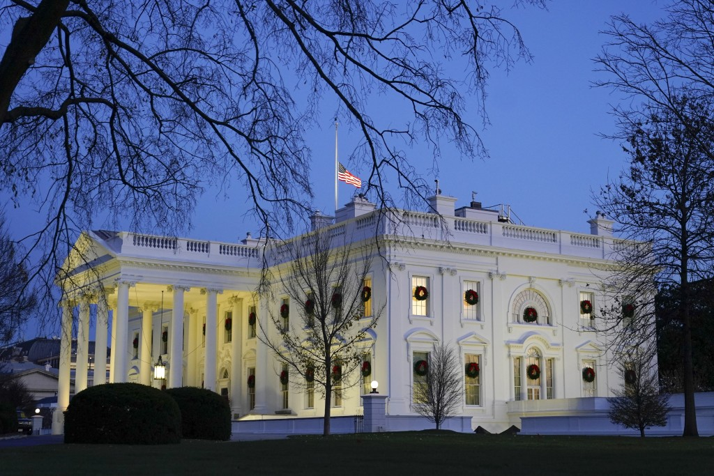 Dusk settles over the White House, Monday, Dec. 7, 2020, in Washington. (AP Photo/Patrick Semansky)