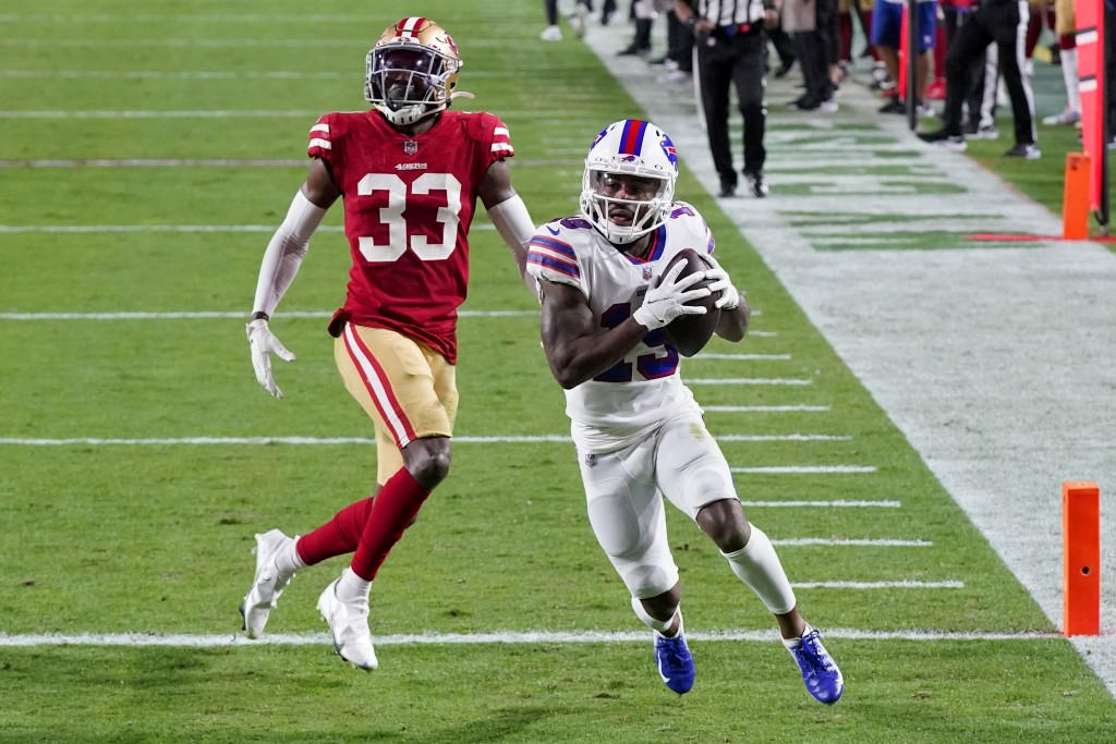 Buffalo Bills wide receiver Isaiah McKenzie (19) scores a touchdown as San Francisco 49ers defensive back Tarvarius Moore (33) defends during the seco...