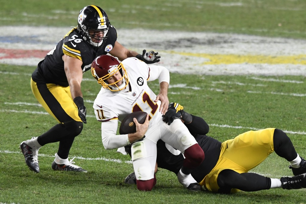 Washington Football Team quarterback Alex Smith (11) is sacked by Pittsburgh Steelers defensive end Stephon Tuitt (91) and Alex Highsmith (56) during ...