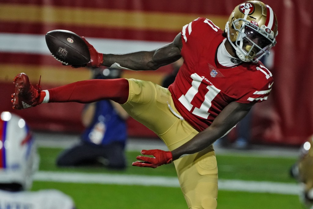 San Francisco 49ers wide receiver Brandon Aiyuk (11) celebrates his touchdown catch against the Buffalo Bills during the first half of an NFL football...