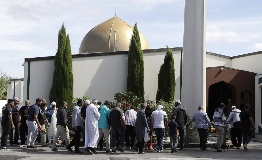FILE - In this March 23, 2019 file photo, worshippers prepare to enter the Al Noor mosque following the previous week's mass shooting in Christchurch,...