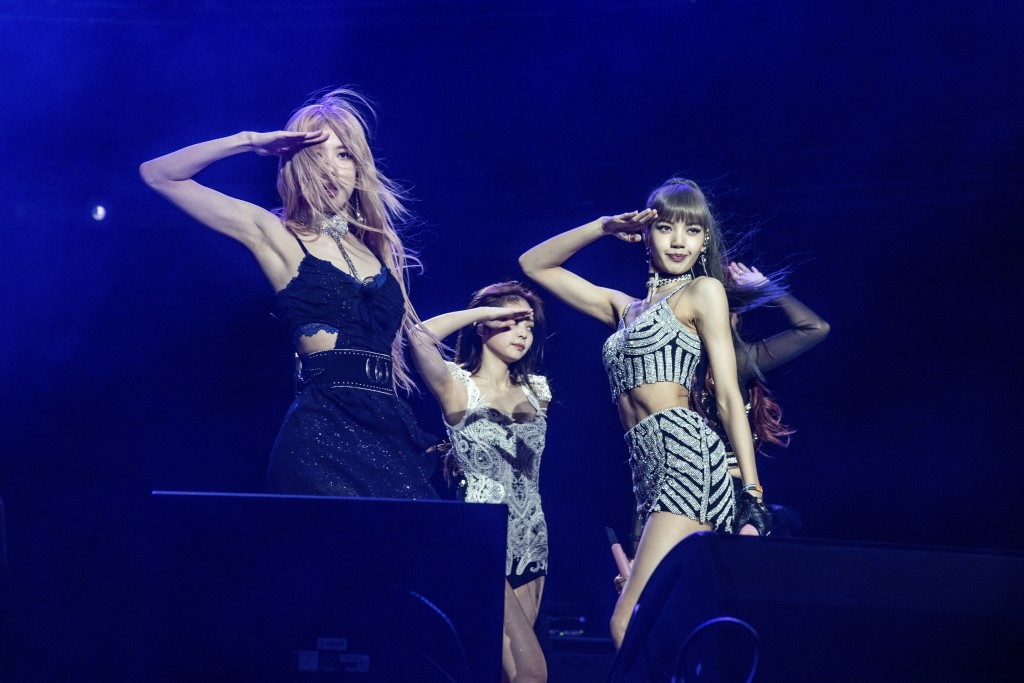 FILE - Rose, from left, Jenni Kim, and Lisa of Blackpink perform at the Coachella Music & Arts Festival in Indio, Calif. on April 12, 2019.  Their son...