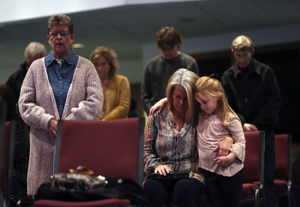 Angela Tucker hugs her 5-year-old granddaughter, Charley Jones, as they pray with their fellow congregants at Calvary of Neosho, a Southern Baptist ch...