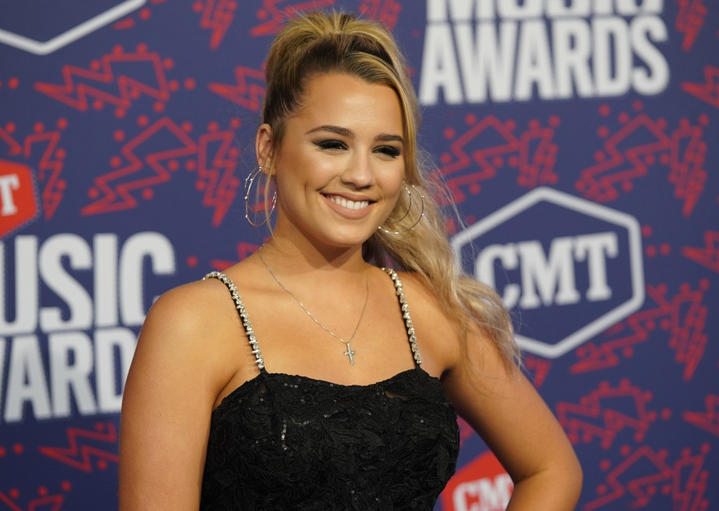 """FILE - Gabby Barrett arrives at the CMT Music Awards in Nashville, Tenn. on June 5, 2019. Barrett's song """"I Hope,"""" featuring Charlie Puth, was named o..."""
