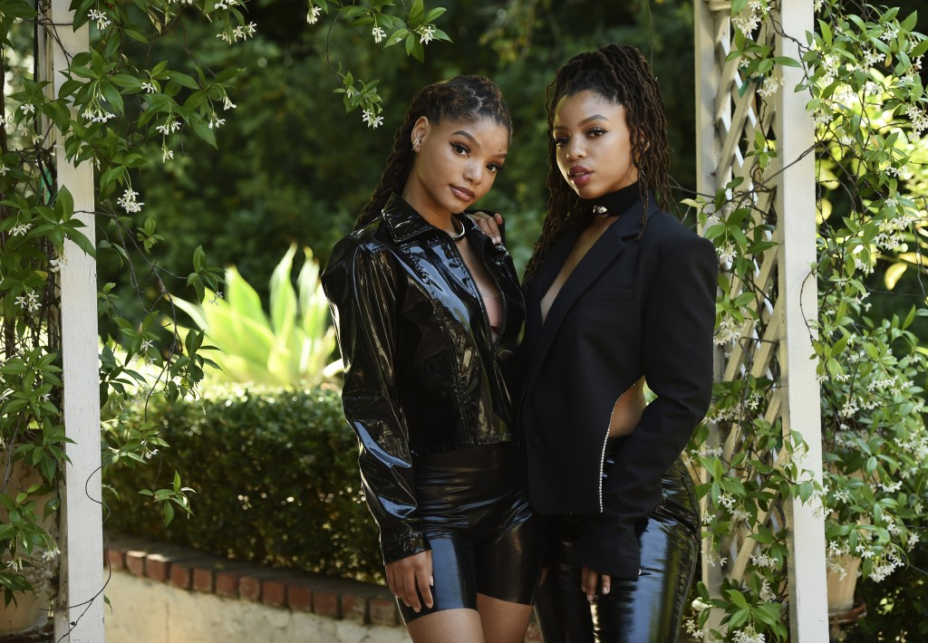 FILE - In this May 28, 2020 photo, Halle Bailey, left, and her sister Chloe Bailey, of the R&B duo Chloe X Halle, pose for a portrait in their backyar...
