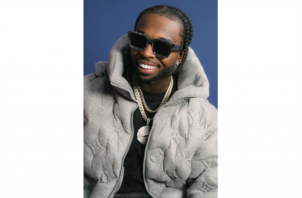 """FILE - This image released by Republic Records shows rapper Pop Smoke. The late rapper's song """"For the Night,"""" featuring DaBaby and Lil Baby, was name..."""