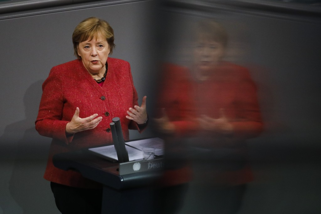 German Chancellor Angela Merkel delivers her speech during the debate about Germany's budget 2021, at the parliament Bundestag in Berlin, Germany, Wed...