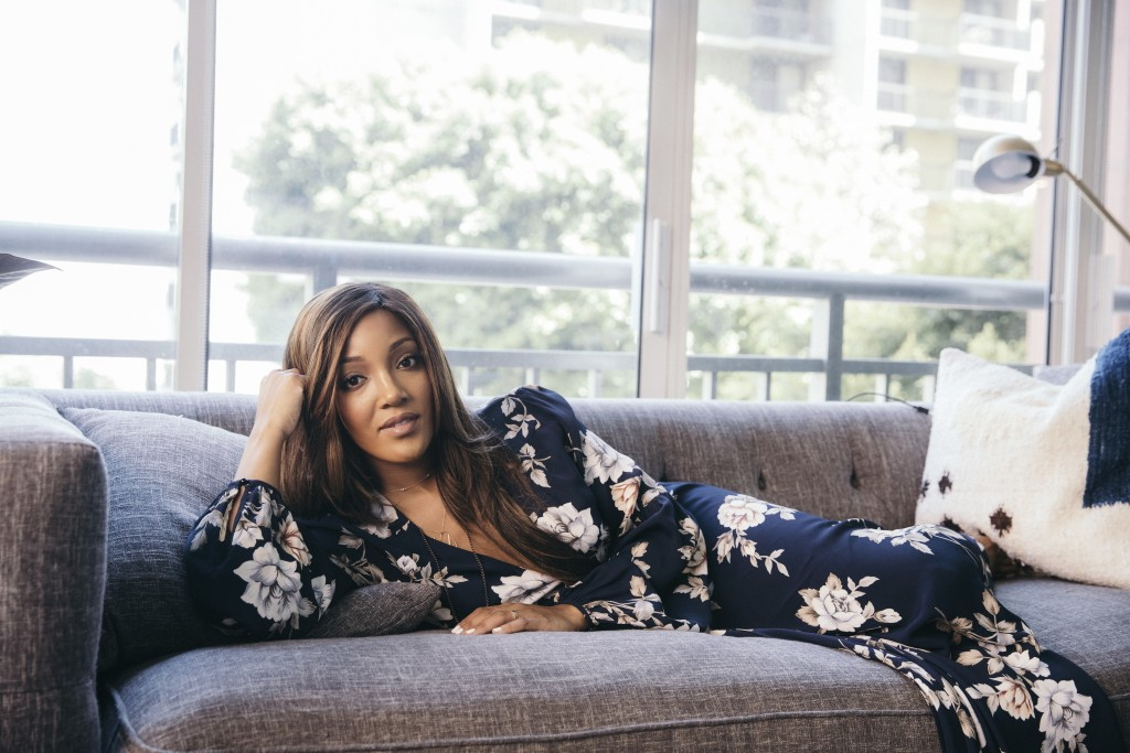 """FILE - In this Aug. 3, 2020 photo, Mickey Guyton appears in Los Angeles. Guyton's song """"Black Like Me"""" was named one of the top 10 of the year by the ..."""