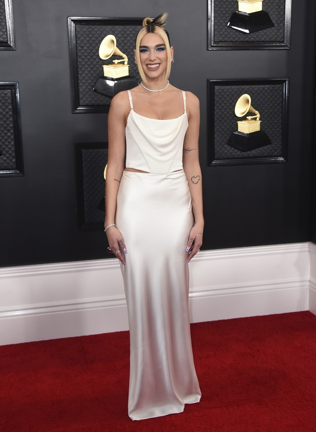 """FILE - This Jan. 26, 2020 file photo shows Dua Lipa at the 62nd annual Grammy Awards in Los Angeles. Dua Lipa's song """"Don't Start Now"""" was named one o..."""